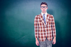 Composite image of geeky hipste rlooking at camera Royalty Free Stock Photo