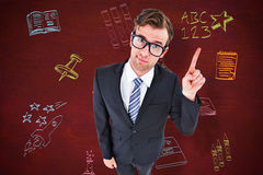 Composite image of geeky hipster businessman with finger up Royalty Free Stock Images