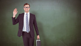 Composite image of geeky hipster businessman waving at camera Royalty Free Stock Images