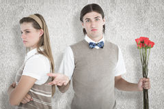 A Composite image of geeky hipster couple not talking after argument Stock Image