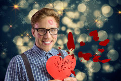 Composite image of geeky hipster covered in kisses Royalty Free Stock Photos