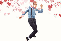 Composite image of geeky hipster dancing to vinyl Stock Photo