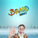 Composite image of geeky hipster doing the ok sign Royalty Free Stock Image