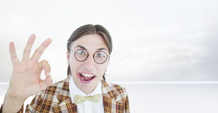 Composite image of geeky hipster doing the ok sign Stock Photo