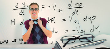 Composite image of geeky hipster fixing his bow tie Stock Images