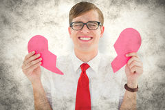A Composite image of geeky hipster holding a broken heart card Stock Photos