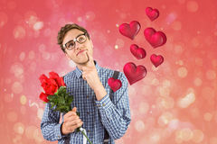 Composite image of geeky hipster holding a bunch of roses Royalty Free Stock Photo