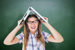 Composite image of geeky hipster holding her laptop over her head Royalty Free Stock Photography