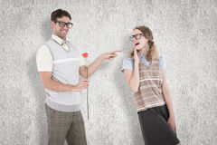 A Composite image of geeky hipster holding rose and pointing his girlfriend Stock Photography