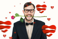 Composite image of geeky hipster holding rose between teeth Royalty Free Stock Photos