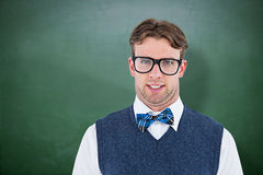 Composite image of geeky hipster looking at camera Stock Images