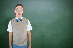 Composite image of geeky hipster looking at camera Royalty Free Stock Photo