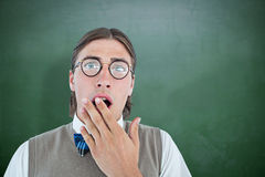 Composite image of geeky hipster looking surprised at camera Royalty Free Stock Photography