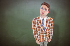 Composite image of geeky hipster looking up Stock Photography