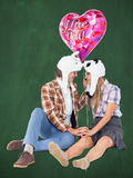 A Composite image of geeky hipster in love couple looking at each other Stock Images