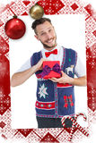 Composite image of geeky hipster offering christmas gift Royalty Free Stock Photos