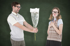 A Composite image of geeky hipster offering flowers to his girlfriend Royalty Free Stock Image