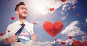 Composite image of geeky hipster opening shirt superhero style Royalty Free Stock Photos