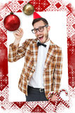 Composite image of geeky hipster in party hat pointing Royalty Free Stock Photos