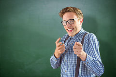 Composite image of geeky hipster pointing at camera Royalty Free Stock Images