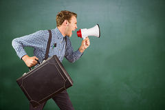 Composite image of geeky hipster shouting through megaphone Royalty Free Stock Photography