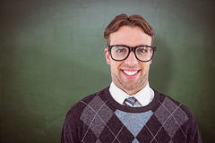 Composite image of geeky hipster smiling at camera Royalty Free Stock Images
