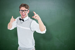 Composite image of geeky hipster in sweater vest dancing Royalty Free Stock Photos