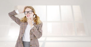 Composite image of geeky hipster thinking with hands on chin and temple Royalty Free Stock Image