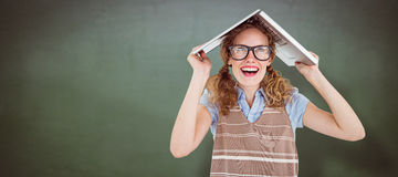 Composite image of geeky hipster woman covering her head with her laptop Stock Photography