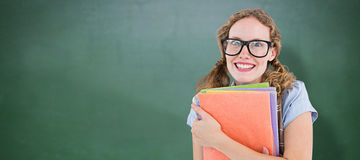 Composite image of geeky hipster woman holding files Stock Photos