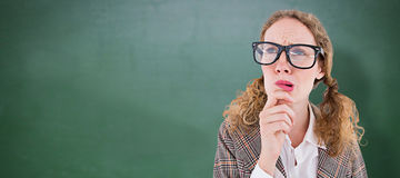 Composite image of geeky hipster woman thinking with hand on chin Royalty Free Stock Image
