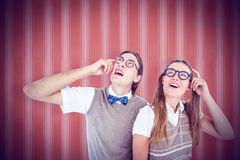 Composite image of geeky hipsters looking confused Stock Image