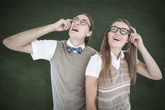 A Composite image of geeky hipsters looking confused Stock Photo