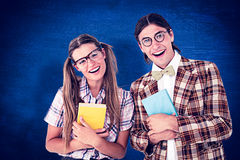 Composite image of geeky hipsters smiling at camera Stock Image