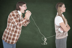 A Composite image of geeky hipsters using string phone Stock Image