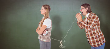 Composite image of geeky hipsters using string phone Stock Photography