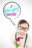 Composite image of geeky lovesick hipster holding rose Royalty Free Stock Images