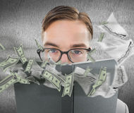 Composite image of geeky man looking over book Stock Image