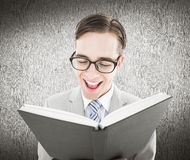Composite image of geeky preacher reading from black bible Royalty Free Stock Photo