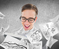 Composite image of geeky preacher reading from black bible Royalty Free Stock Images