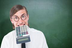 Composite image of geeky smiling businessman biting calculator Stock Photos