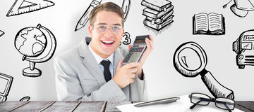 Composite image of geeky smiling businessman holding calculator Stock Photography