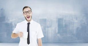 Composite image of geeky smiling businessman holding mug Stock Photo