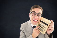 Composite image of geeky smiling businessman showing calculator Stock Photos
