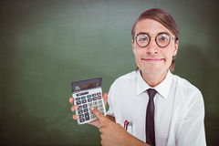 Composite image of geeky smiling businessman showing calculator Stock Photo
