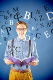 Composite image of geeky student reading a book Stock Photography