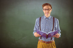 Composite image of geeky student reading a book Royalty Free Stock Photography