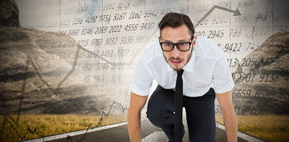 Composite image of geeky young businessman ready to race Royalty Free Stock Photography