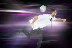 Composite image of geeky young businessman running late Stock Images