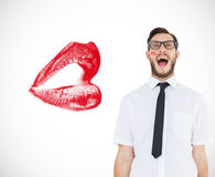 Composite image of geeky young businessman shouting loudly. Geeky young businessman shouting loudly against white background with vignette Royalty Free Stock Images